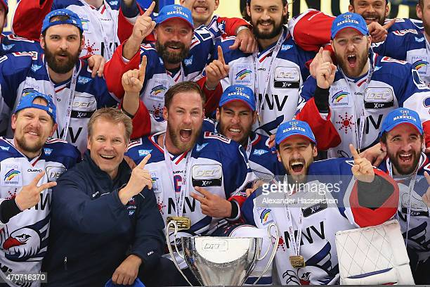 The team of Mannheim celebrates winning the German Championship title after winning the DEL Playoffs Final Game 6 between ERC Ingolstadt and Adler...