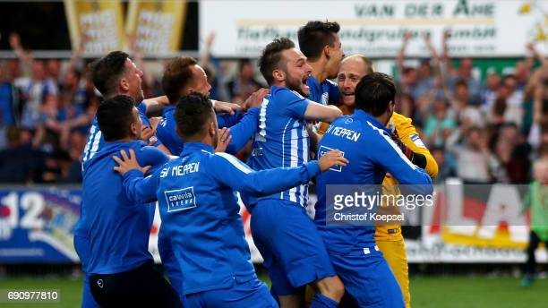 The team of Meppen celebrastes with Benjamin Gommert after winning 3 after penalty shootout the Relegation Regionalliga Play Off second leg match at...
