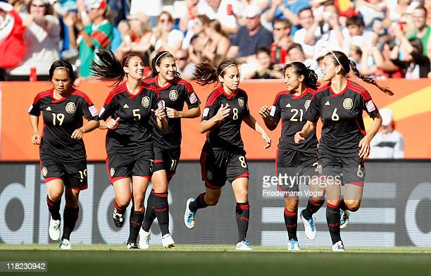 The team of Mexico celebrates scoring the first goal during the FIFA Women's World Cup 2011 Group B match between New Zealand and Mexico at...