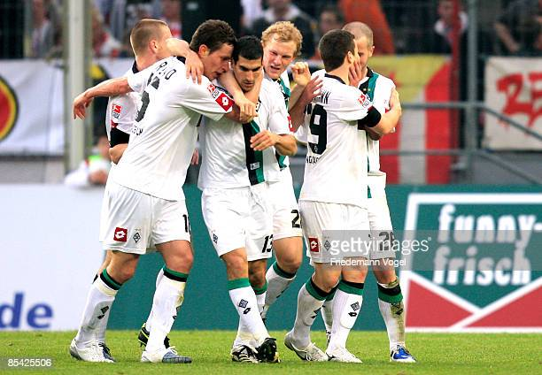The team of M'gladbach celebrates after the third goal during the Bundesliga match between 1. FC Koeln and Borussia Moenchengladbach at the...