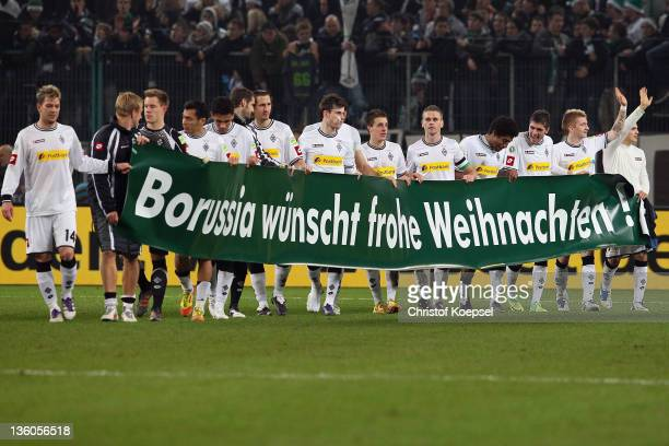 The team of Moenchengladbach celebrates the 31 victory with a banner after the DFB Cup round of sixteen match between Borussia Moenchengladbach and...