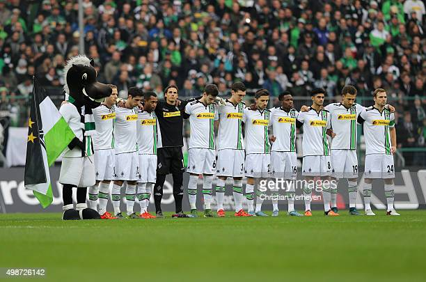 The team of Moenchengladbach hold a minute's silence of support for the 130 victims of the terrorist attack in Paris during the Bundesliga match...