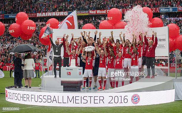 The team of Muenchen celebrate the Bundesliga championship with the trophy after the Bundesliga match between FC Bayern Muenchen and Hannover 96 at...