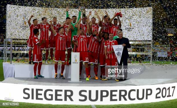 The team of Muenchen celebrate victory over Dortmund after poenakty shoot out during the DFL Supercup 2017 match between Borussia Dortmund and Bayern...