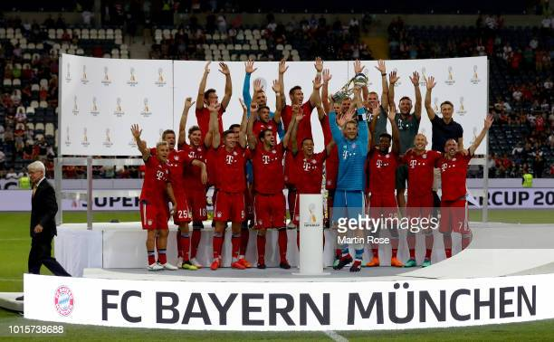 The team of Muenchen celebrate winning the Supercup 2018 after the DFL Supercup 2018 between Eintracht Frankfurt and Bayern Muenchen at...