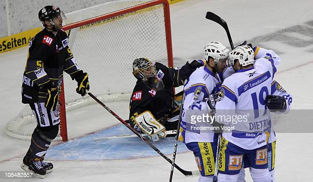 The team of Muenchen celebrates scoring the second goal during the DEL match between Krefeld Pinguine and EHC Muenchen at the Koenigs Palast on...