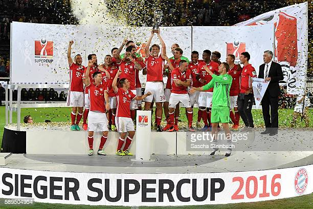 The team of Muenchen celebrates with the trophy after winning the DFL Supercup 2016 match against Borussia Dortmund at Signal Iduna Park on August 14...