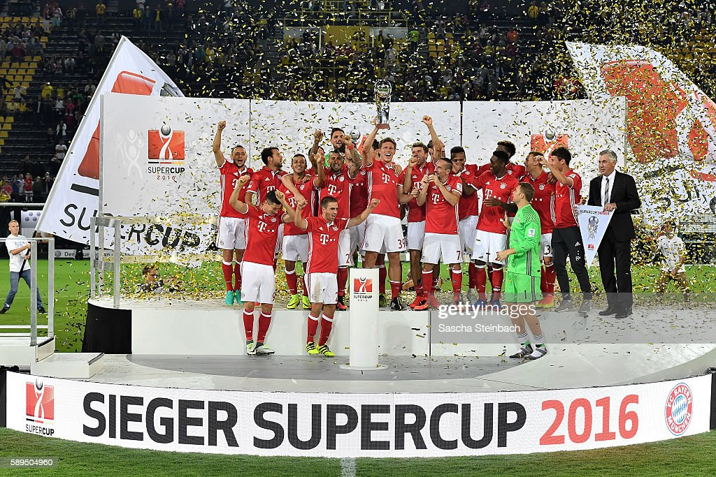 The team of Muenchen celebrates with the trophy after winning the DFL Supercup 2016 match against Borussia Dortmund at Signal Iduna Park on August 14, 2016 in Dortmund, Germany.