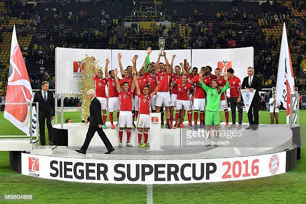The team of Muenchen receives the trophy after winning the DFL Supercup 2016 match against Borussia Dortmund at Signal Iduna Park on August 14 2016...
