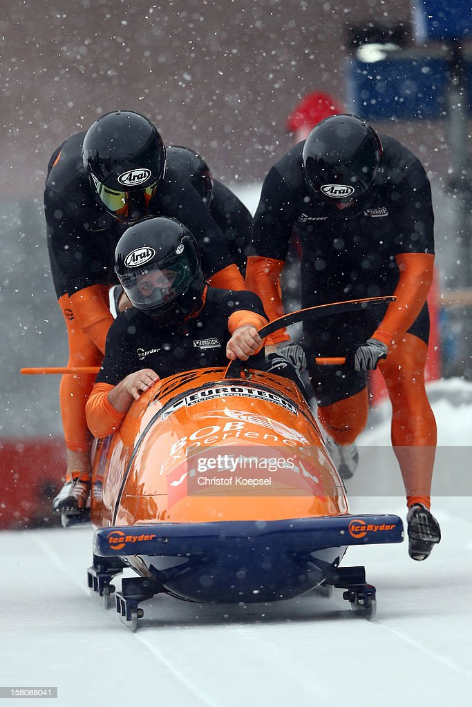 The team of Netherlands 2 with Ivo de Bruin, Thierry Kruithoff, Bror van der Zijde and Timothy Beck sprints during the four men's bob competition during the FIBT Bob & Skeleton World Cup at Bobbahn Winterberg on December 9, 2012 in Winterberg, Germany.