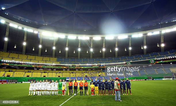 The team of New Zealand and of France line up before the FIFA U20 Women's World Cup 2014 group D match between New Zealand and France at Olympic...