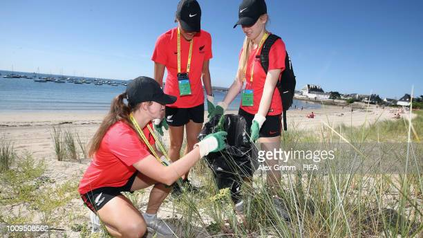 The team of New Zealand cleans up the beach during the FIFA U-20 Women's World Cup France 2018 on August 2, 2018 in Lorient, France.
