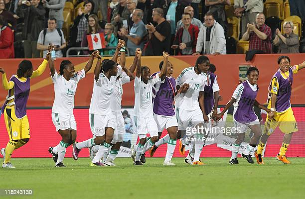 The team of Nigeria celebrate after the FIFA Women's World Cup 2011 Group A match between Canada and Nigeria at RudolfHarbigStadion on July 5 2011 in...