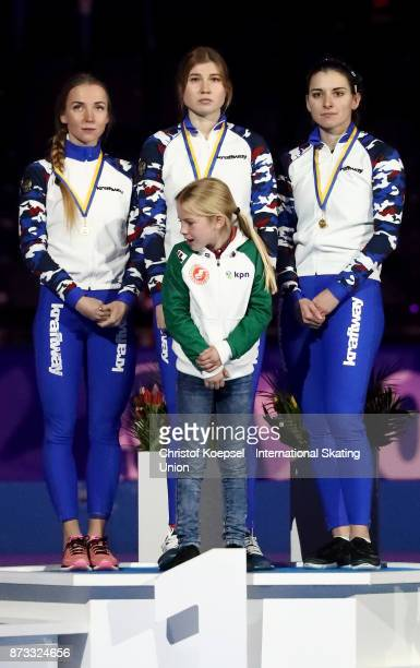 The team of Norway with Anne Gulbrandsen Hege Boekko and Ida Njatun poses during the medal ceremony after winning the 2nd place the team of Russia...