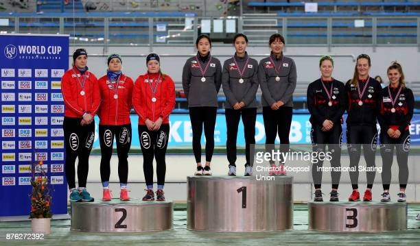 The team of Norway with Anne Gulbrandsen, Hege Boekko and Ida Njatun poses during the medal ceremony after winning the 2nd place, the team of Korea...