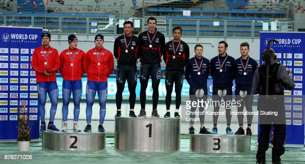 The team of Norway with Havard Holmefjord Lorentzen Bjoern Magnussen and Henrik Rukke poses during the medal ceremony after winning the 2nd place the...