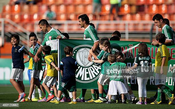 The team of Palmeiras walks in before the match between Palmeiras and Bahia for the Brazilian Series A 2014 at Estadio do Pacaembu on August 3 2014...