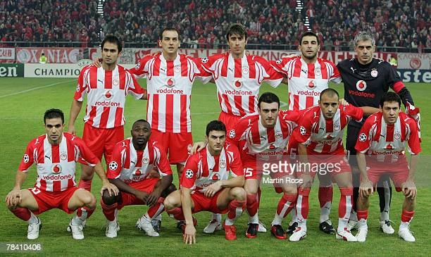 The team of Piraeus lines up prior the UEFA Champions League Group C match between Olympiakos and Werder Bremen at the Karaiskakis Stadium on...