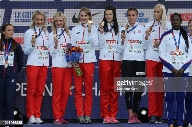 The team of Poland gold pose with their medals for the Women's 4x400 metres Relay during day six of the 24th European Athletics Championships at...