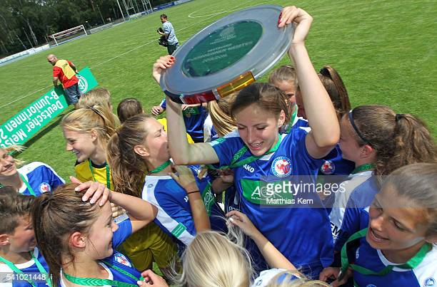 The team of Potsdam celebrate with the trophy after winning the U17 Girl's German Championship final match between 1FFC Turbine Potsdam and FSV...