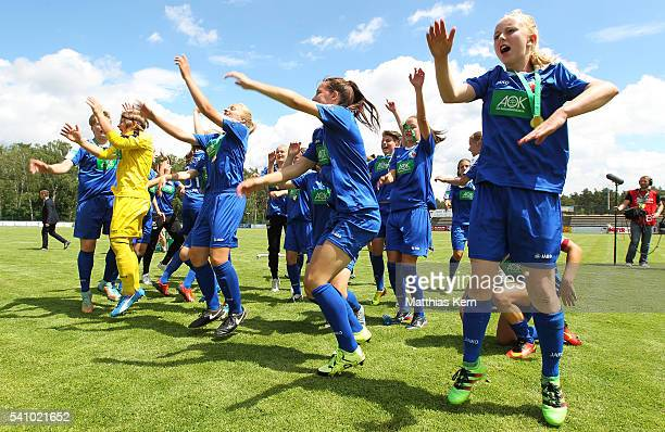 The team of Potsdam celebrate with their supporters after winning the U17 Girl's German Championship final match between 1FFC Turbine Potsdam and FSV...