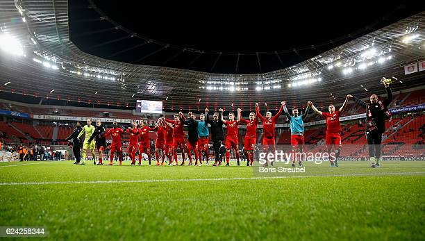 The team of RB Leipzig celebrate with their fans after winning the Bundesliga match between Bayer 04 Leverkusen and RB Leipzig at BayArena on...