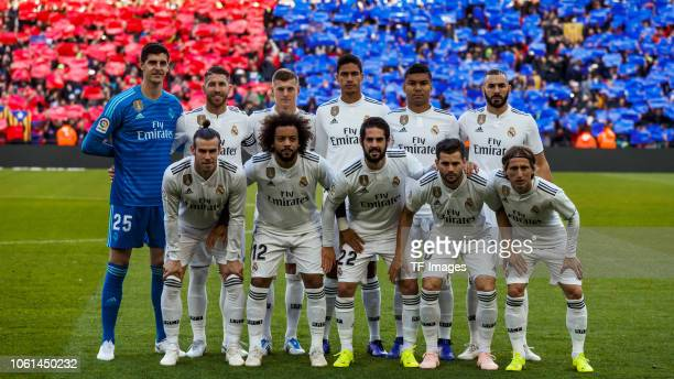 The team of Real Madrid pose for a photo prior the La Liga match between FC Barcelona and Real Madrid CF at Camp Nou on October 28, 2018 in...