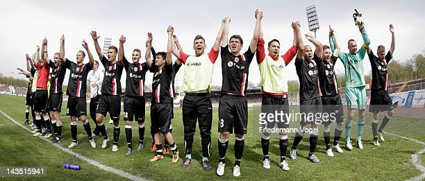 The team of Regensburg celebrates after winning the Third League match between RW Oberhausen and Jahn Regensburg at the Niederrhein Stadium on April...