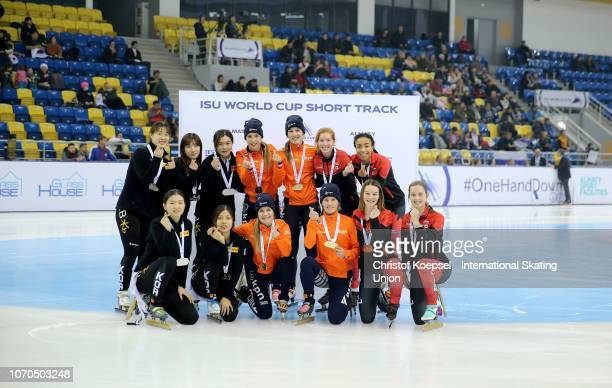 The team of Republic of Korea with Choi Min Jeong Kim Geon Hee Kim Ji Yoom and Shim Suk Hee poses after winning the second place the team of the...