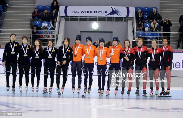 The team of Republic of Korea with Kim Geon Hee Kim Ji Yoom and Shim Suk Hee poses after winning the second place the team of the Netherlands with...