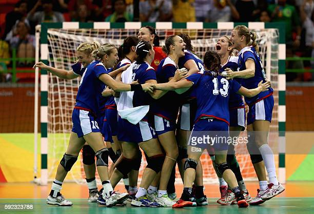 The team of Russia celebrates their victory following the Women's Handball Gold medal match between France and Russia at Future Arena on Day 15 of...
