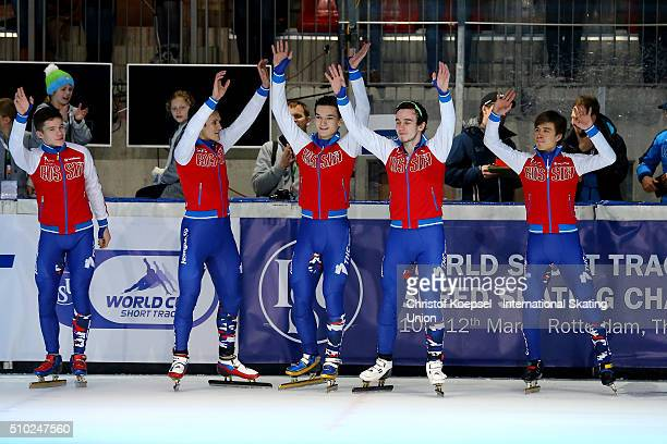The team of Russia poses during the medal ceremony after winning the 1st place of the men 5000m relay final A during Day 3 of ISU Short Track World...