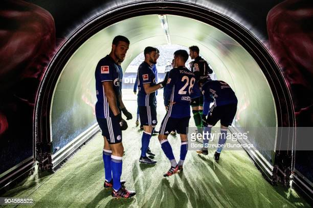 The team of Schalke 04 enter the pitch through the players tunnel for the second half during the Bundesliga match between RB Leipzig and FC Schalke...