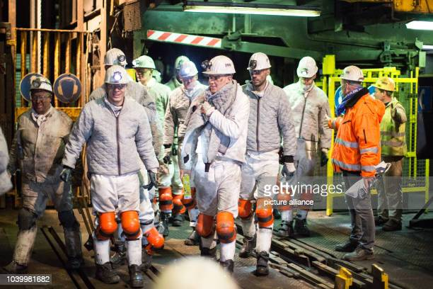 The team of Schalke 04 step out of the elevator of a pit on the premises of the Mine ProperHaniel in Bottrop Germany 18 January 2017 The team of...