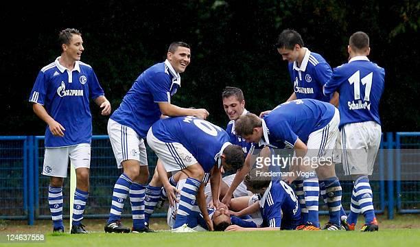 The team of Schalke after celebrates scoring their second goal during the A-Junioren match between FC Schalke 04 and Borussia Dortmund on September...