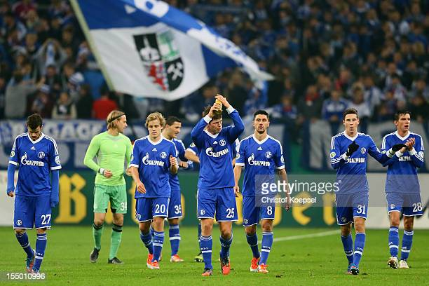 The team of Schalke celebrates after the DFB Cup second round match between FC Schalke 04 and SV Sandhausen at Veltins-Arena on October 30, 2012 in...