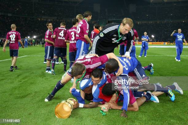 The team of Schalke celebrates after winning 50 the DFB Cup final match between MSV Duisburg and FC Schalke 04 at Olympic Stadium on May 21 2011 in...