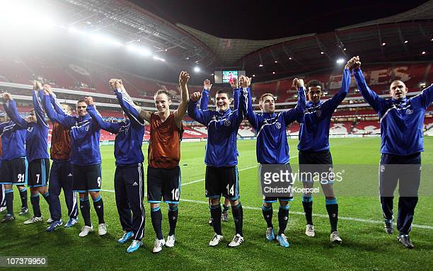The team of Schalke celebrates the 21 victory after the UEFA Champions League group B match between Benfica Lisbon and FC Schalke 04 at Estádio da...