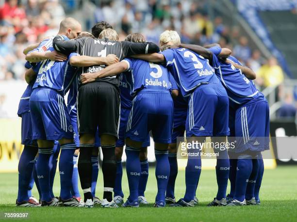 The team of Schalke form a circle before the Premiere Liga Cup match between FC Schalke 04 and Karlsruher SC at the LTU Arena on July 21 2007 in...