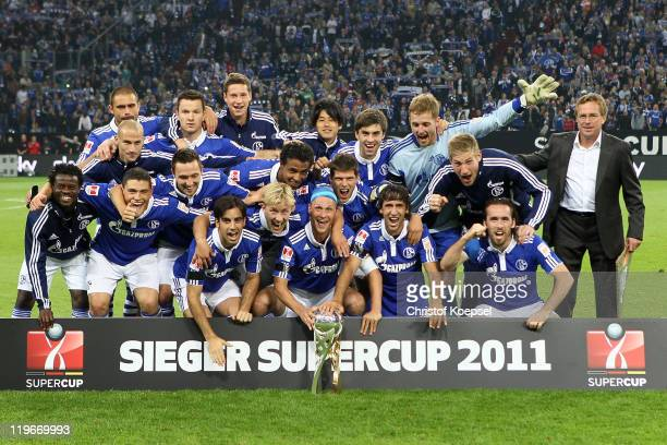 The team of Schalke poses with the Supercupo trophy after winning the Supercup match between FC Schalke 04 and Borussia Dortmund at Veltins Arena on...