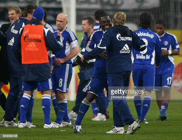 The team of Schalke with Gerald Asamoah and assistant coach Mike Bueskens celebrate the 1-0 victory after the Bundesliga match between FC Schalke 04...