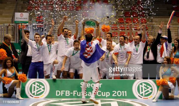 The team of SD Croatia Berlin celebrates after winning the final match against FC Bayern Kickers Nuernberg during the DFB Futsal Cup at ring arena on...