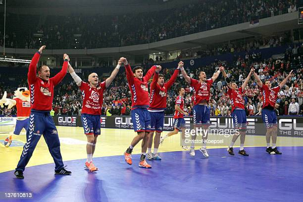 The team of Serbia celebrates the 24-21 victory after the Men's European Handball Championship second round group one match between Serbia and Sweden...