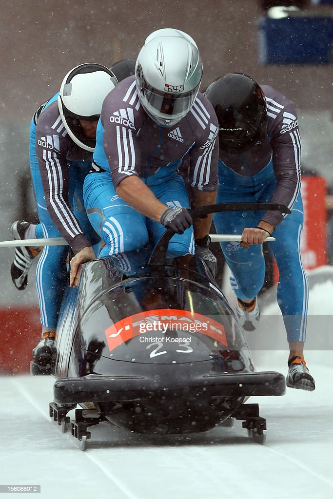 The team of Serbia with Vuk Radjenovic, Uros Stegel, Nikola Milinkovic and Damjan Zlatnar sprint during the four men's bob competition during the FIBT Bob & Skeleton World Cup at Bobbahn Winterberg on December 9, 2012 in Winterberg, Germany.