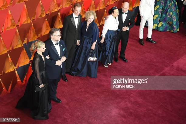 The team of 'Shape of Water' with Director Guillermo del Toro arrive for the 90th Annual Academy Awards on March 4 in Hollywood California / AFP...