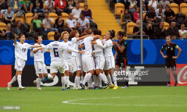 The team of South Korea celebrate their opening goal during the 2010 FIFA Women's World Cup Quarter Final match between Mexico and South Korea at the...