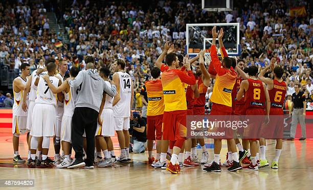 The team of Spain celebrate while the team of Germany look dejected after the FIBA EuroBasket 2015 Group B basketball match between Germany and Spain...
