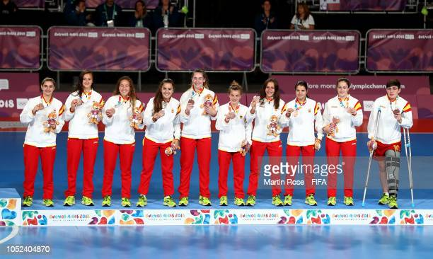 The team of Spain celebrate winning the bronze medal after the Women's Futsal Final match between Portugal and Japan during the Buenos Aires Youth...