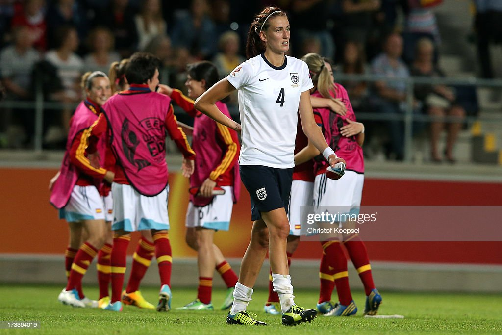 The team of Spain celebrates the 3-2 victory and Jill Scott of England looks dejected after the UEFA Women's EURO 2013 Group C match between England and Spain at Linkoping Arena on July 12, 2013 in Linkoping, Sweden.