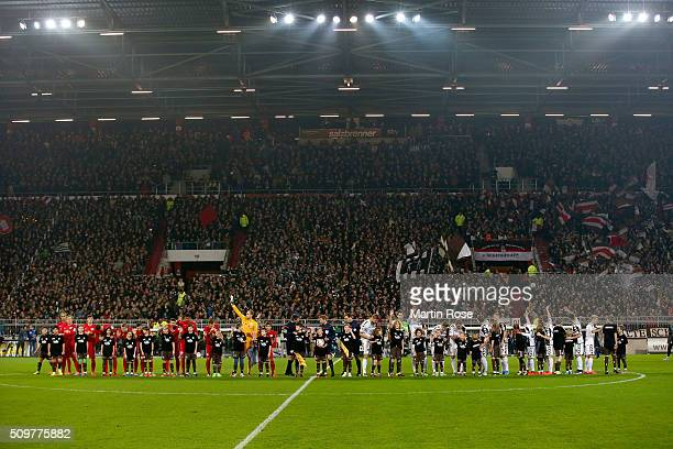 The team of St Pauli and of Leipzig line up before the second Bundesliga match between FC St Pauli and RB Leipzig at Millerntor Stadium on February...
